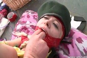 Связанная девушка с заклеенным ртом